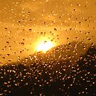 I see sunshine through the pouring rain by millymuso