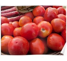 Pile of red luscious tomatoes along with carrots on a vegetable basket Poster