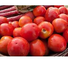Pile of red luscious tomatoes along with carrots on a vegetable basket Photographic Print