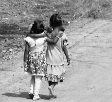 BLACK AND WHITE-JUST TWO FRIENDS WALKING DOWN THE ROAD-WHERE DOES THE JOURNEY LEAD? by HEARTSFORINDIA