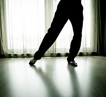 Legs of man dancing with white shoes and black by GemaIbarra