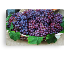 Basket of red grapes...... Canvas Print