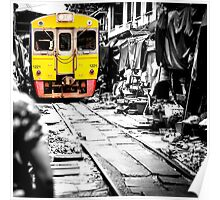 Train coming toward the market with food still on the ground. Poster