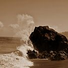 Waves vs. Rocks by Omar Dakhane