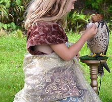 The Gentle Touch Of A Young Falconer In The Making by lynn carter