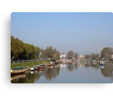 Houseboats on the shore of a canal in Srinagar Canvas Print