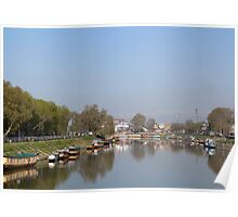 Houseboats on the shore of a canal in Srinagar Poster