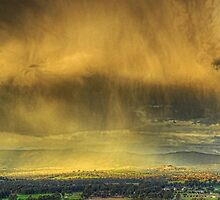 Rainbow & rain curtain, Ovens Valley by Kevin McGennan