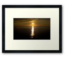 Sunset over the ocean. Framed Print