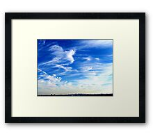 Drifting clouds over New York City  Framed Print