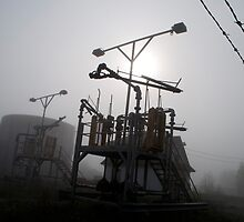 Platforms And Tanks At Petrocor In The Fog by Gary Chapple