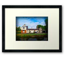 Irish house on the river Framed Print