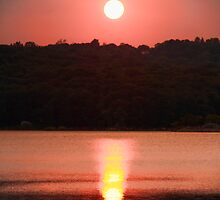 Ripples Of A Sunset by daphsam