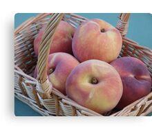 Peaches in a basket  Canvas Print
