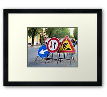 Signs over an hole Framed Print