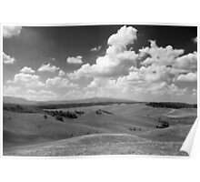 Rolling hills with dramatic sky. Poster