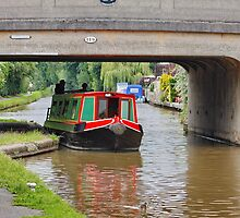 The Canal & Barge Under the Bridge by AnnDixon