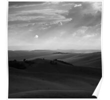 Dramatic sky over rolling hills. Poster