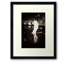 Stealthily the dark haunts round Framed Print