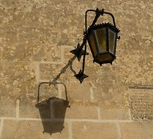 Of Lights and Shadows - Medieval Looking Streetlamp in Mdina, the Ancient Capital of Malta by Georgia Mizuleva