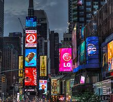 Times Square at night by paulcowell