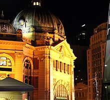 flinders st station at night by natalie angus
