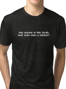 Has anyone in this family ever even seen a chicken? Tri-blend T-Shirt