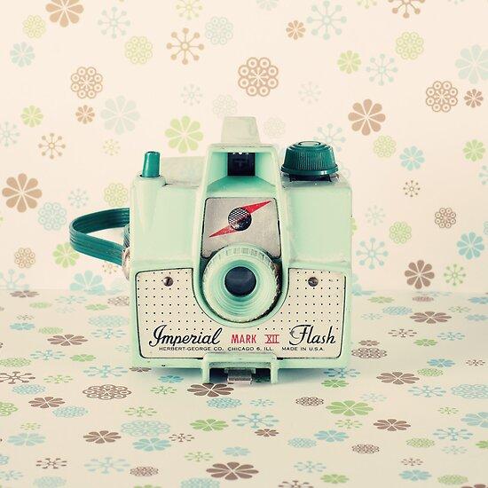 Portfolio retro vintage mint camera on beige pattern background