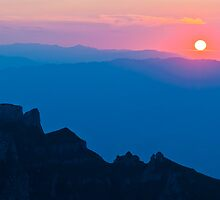 Sunset above the mountains by Catalin Pomeanu