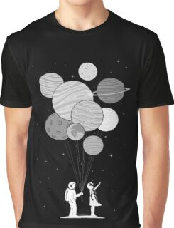 Between planets and balloons. Graphic T-Shirt