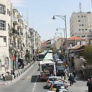 Buses on Jaffa Street, Jerusalem by Carol Singer