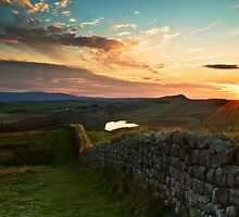 Hadrian's Wall winds over Hotbank Crag by Joan Thirlaway