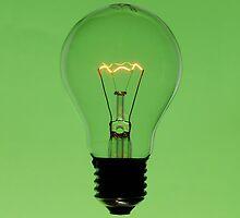 Floating bulb on green background by mattiaterrando