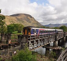 Train at Soldier's bridge near Fort William...Ben Nevis behind by Jacky Cooper