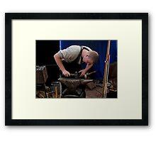 Mettle on metal: a blacksmith's apprentice Framed Print