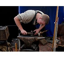 Mettle on metal: a blacksmith's apprentice Photographic Print