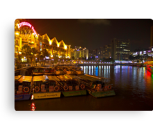 Boats moored to the side at Clarke Quay in Singapore Canvas Print