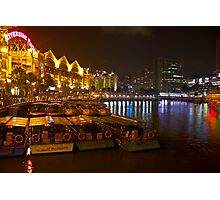 Boats moored to the side at Clarke Quay in Singapore Photographic Print