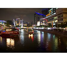 Boat making its way down river at Clarke Quay in Singapore Photographic Print