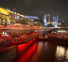 Boats moored on water at Clarke Quay in Singapore  by ashishagarwal74