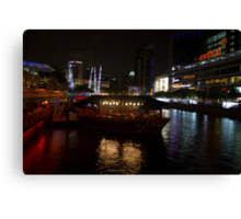 Boats moored at Clarke Quay in Singapore Canvas Print