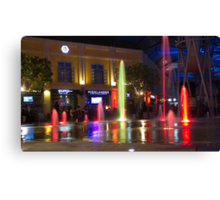 Colorful water jets at Clarke Quay in Singapore Canvas Print