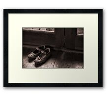 A childs shoes Framed Print