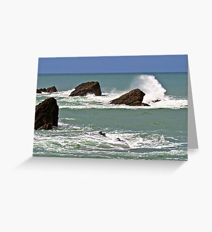 Waves crashing against rocks Greeting Card