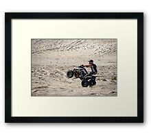 Quad bike doing wheelie Framed Print
