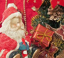 Santa Claus with Christmas  tree and  gift by Sviatlana Kandybovich