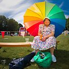 Happy old lady village fete by Heather Buckley