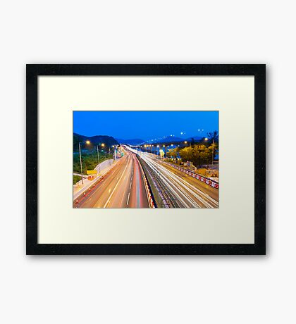 Majestic highway traffic in Hong Kong at night Framed Print