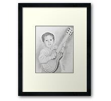 His first guitar Framed Print