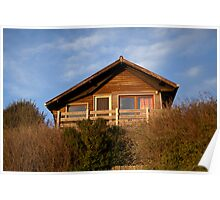 wooden house on a grassy dune Poster